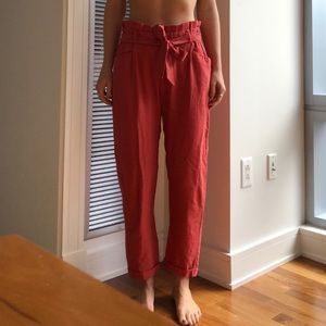 Washed orange paper bag fabric pants